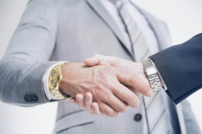 Closeup of a business hand shake stock image