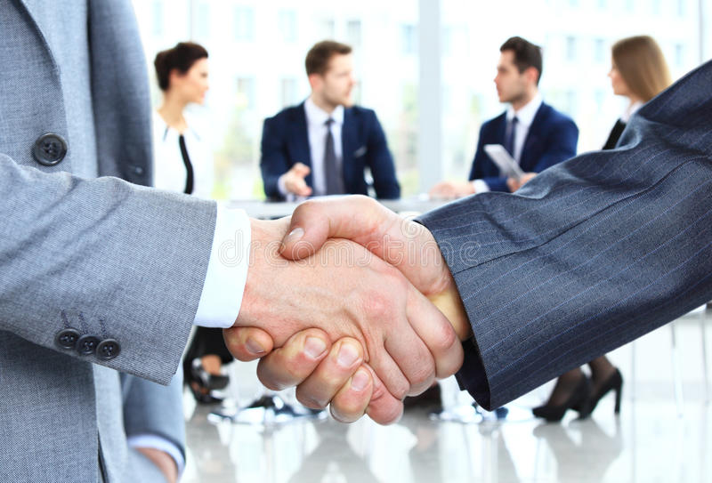 Closeup of a business handshake. Business people shaking hands royalty free stock photography