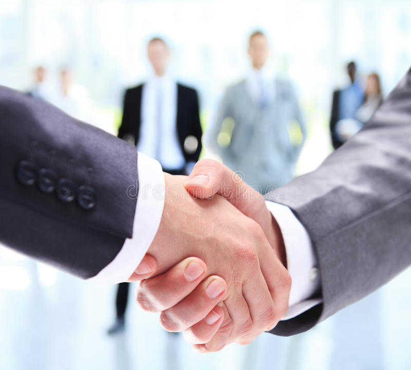 Closeup of a business handshake. Business people shaking hands stock image