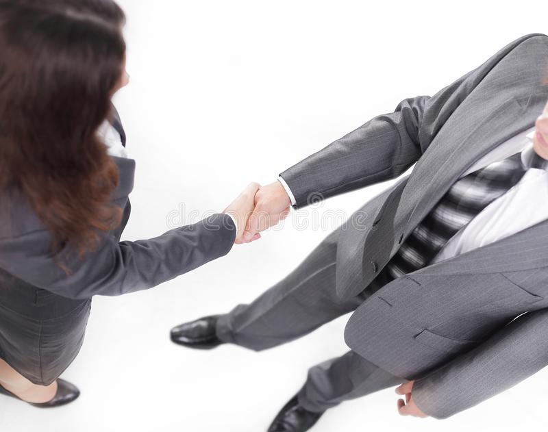 Closeup of a business handshake men and business women. royalty free stock image