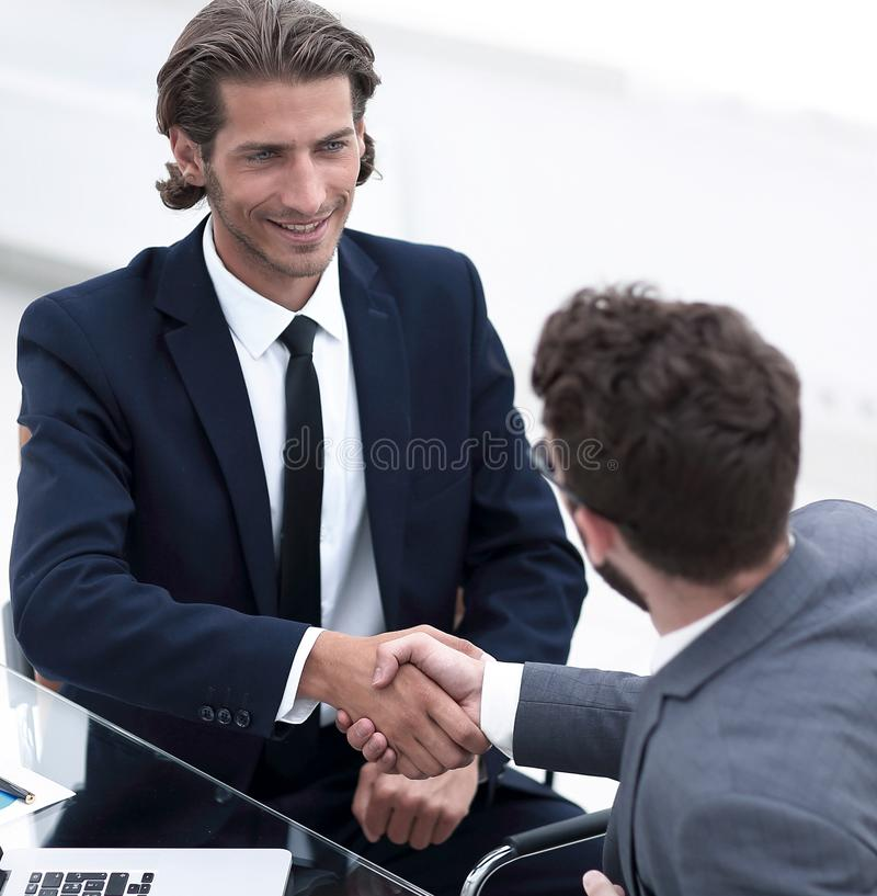 Closeup. business handshake in an office. stock image