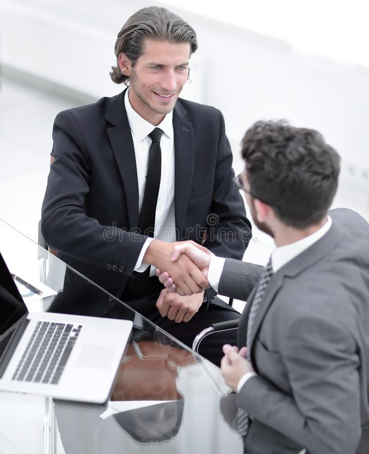 Closeup. business handshake in an office. royalty free stock photography