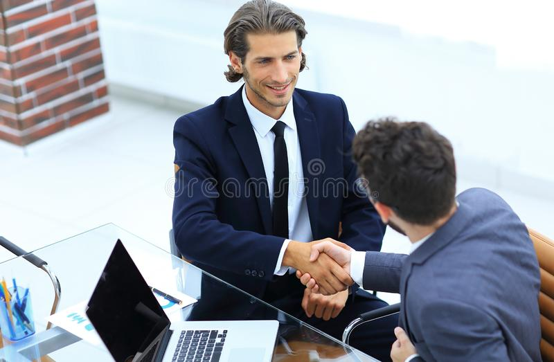 Closeup. business handshake in an office. stock photo