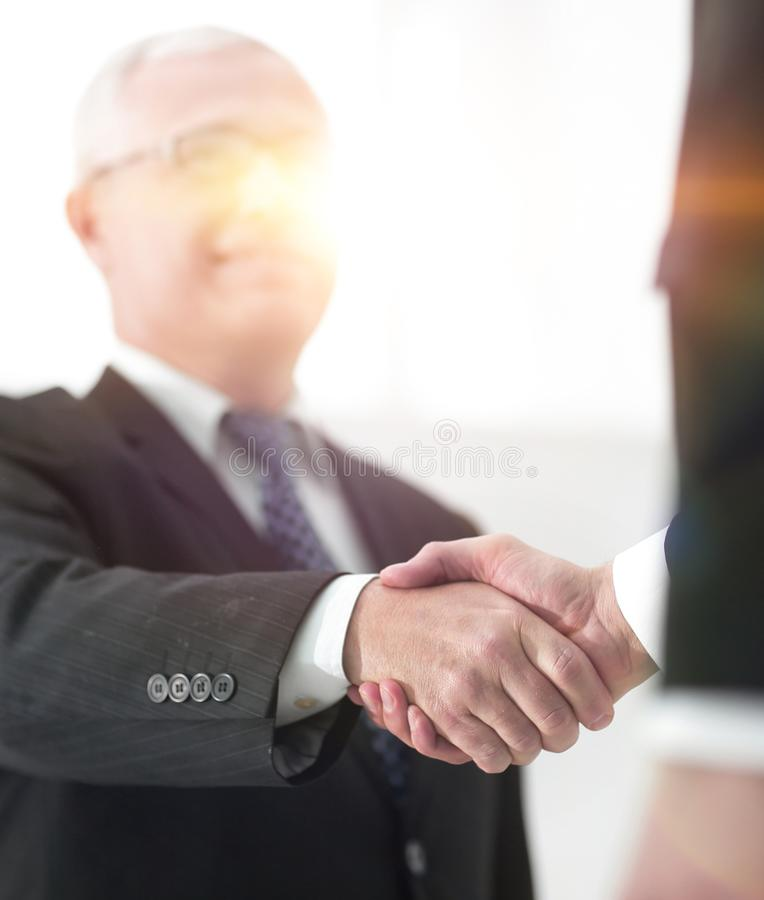 Closeup of a business handshake partners. the image is blurred. stock photos