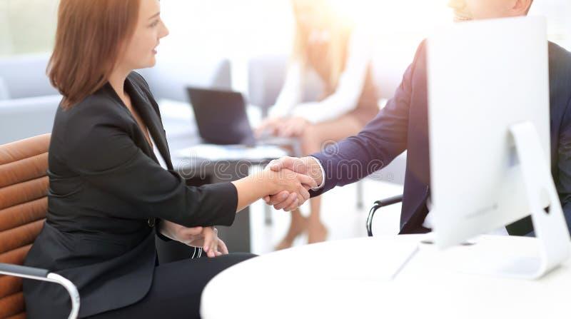 closeup of a business handshake women business partner.the busin stock photo
