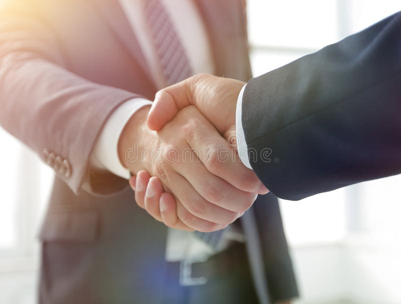Closeup of Business Leader Shaking Partner Hand stock photography
