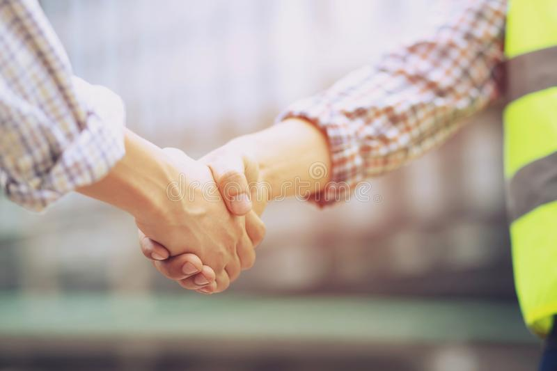 Closeup of a business man hand shake between two colleagues greet stock images