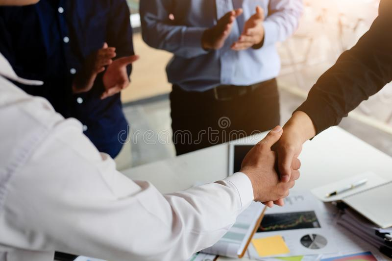 Closeup Business partnership meeting concept. Image businessmans handshake. Successful businessmen handshaking after good deal. stock photo