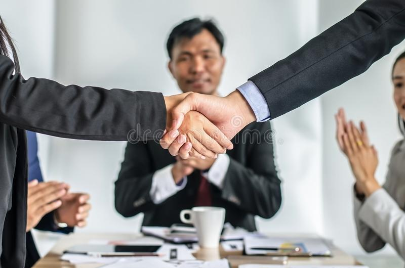 Closeup of a business people shaking hands, finishing up a meet royalty free stock photos