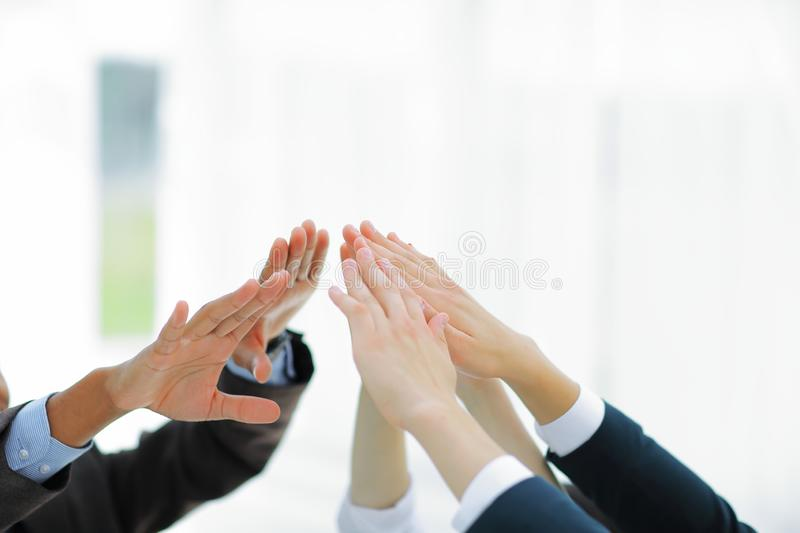 Closeup.business team giving each other a high five. royalty free stock images