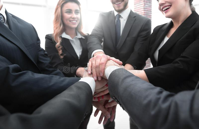 Closeup.business team with hands clasped together. The concept of teamwork stock image