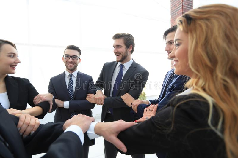 Closeup. business team showing their unity stock image