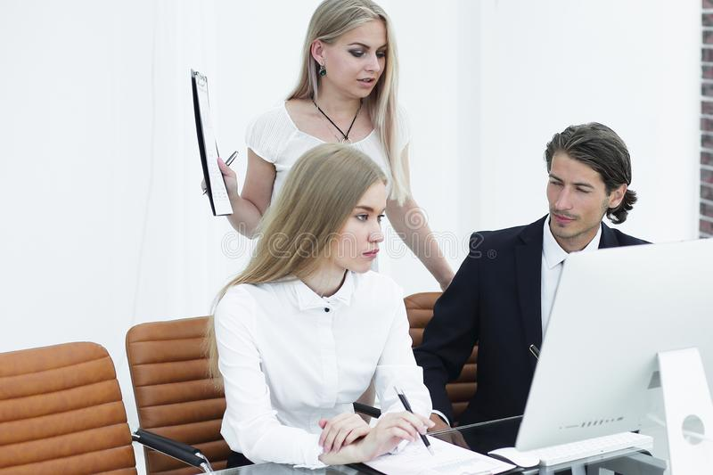 Closeup.business team working with documents in a modern office stock image