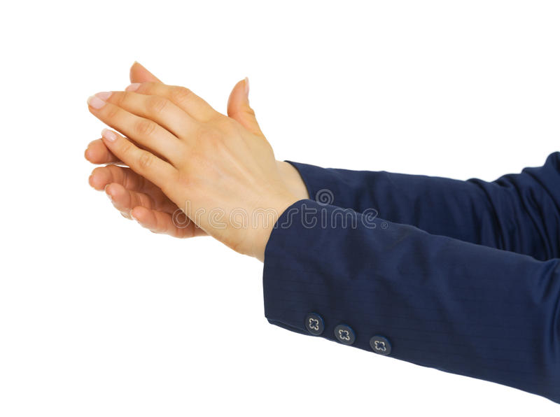 Closeup on business woman clapping. Isolated on white background stock photography