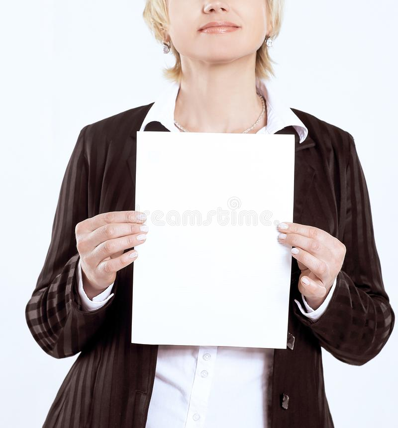 Closeup.business woman holding a blank sheet. isolated on white. royalty free stock photo