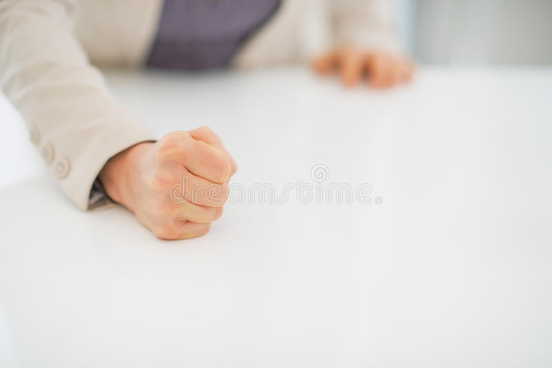 Closeup on business woman knocking on table. With fist stock photos