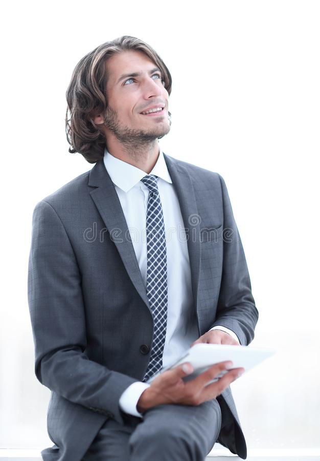 Closeup .businessman with digital tablet looking at copy space stock photography