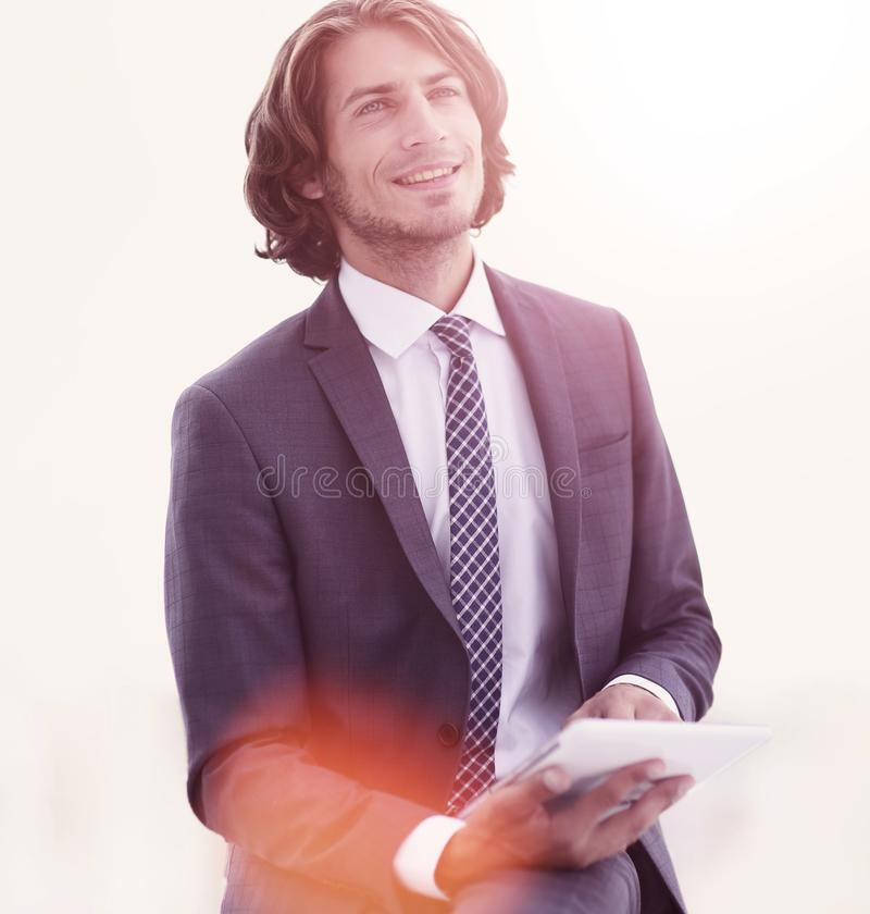 Closeup .businessman with digital tablet looking at copy space royalty free stock photography
