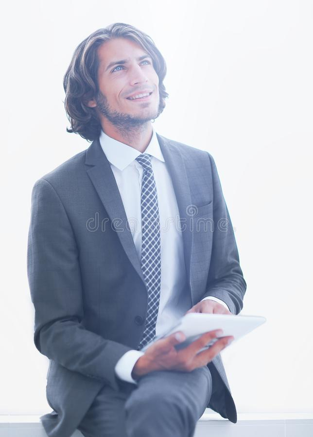 Closeup .businessman with digital tablet looking at copy space royalty free stock photo
