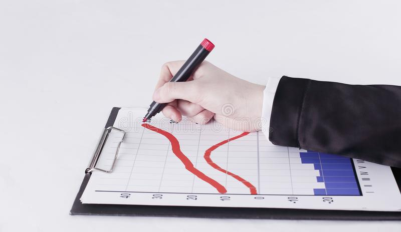Closeup .Businessman drawing a stock chart.isolated on white. Background royalty free stock photography