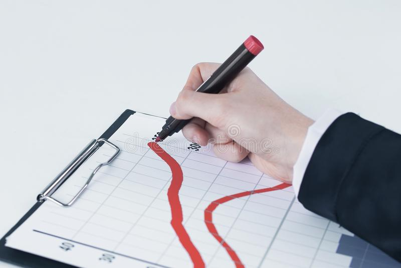 Closeup .Businessman drawing a stock chart. on white. Background stock photos