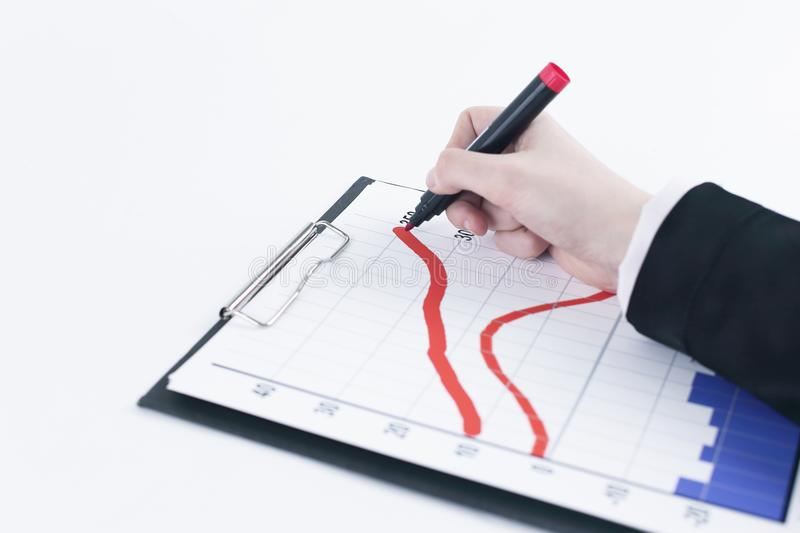 Closeup .Businessman drawing a stock chart. on white. Background stock photo