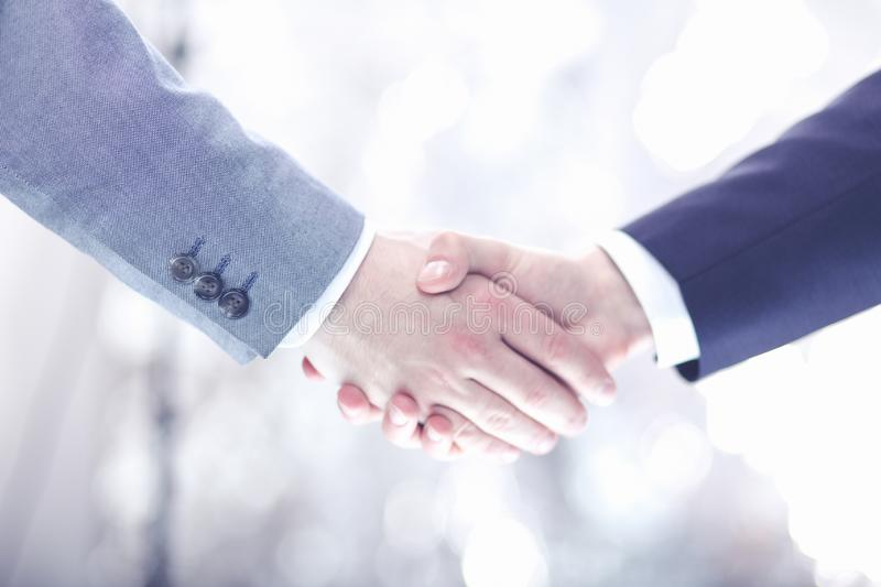 Closeup of a businessman hand shake businesswoman between two colleagues OK, succeed in business stock photography