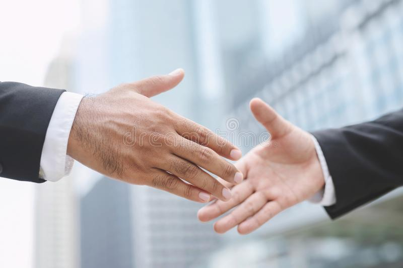 Closeup of a businessman hand shake investor between two colleagues  OK, succeed in business Holding hands. Leave space to write messages royalty free stock photos