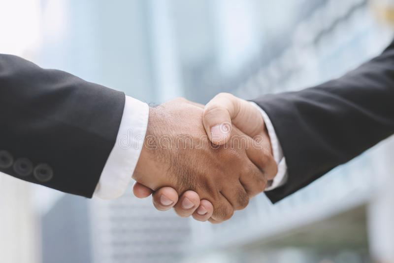 Closeup of a businessman hand shake investor between two colleagues  OK, succeed in business Holding hands. Leave space to write messages royalty free stock image