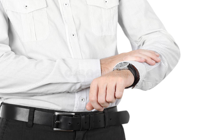 Closeup of businessman hand with watch isolated. Closeup of businessman hand in white shirt with watch isolated royalty free stock photos