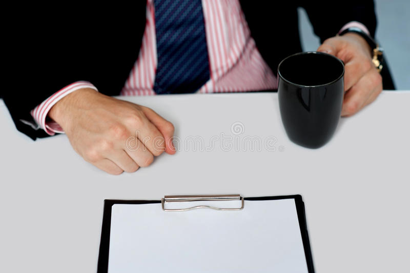 Download Closeup Of Businessman Holding Empty Cup Royalty Free Stock Photography - Image: 25622357