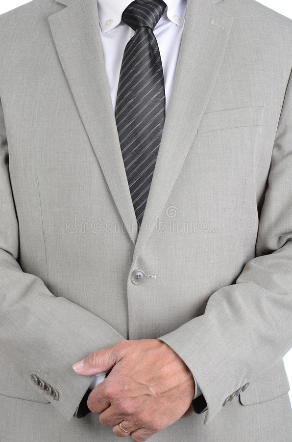 Closeup businessman in a light gray suit and gray striped tie with hands clasped in front, torso only man is unrecognizable stock images