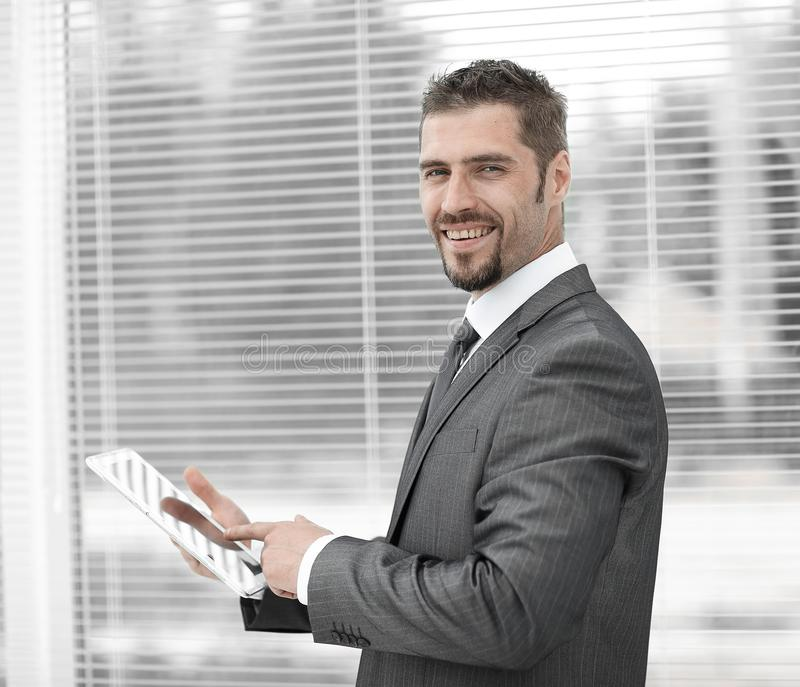 Closeup.businessman with tablet computer standing by the window. royalty free stock photo