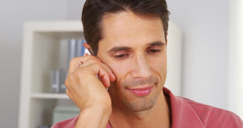 Closeup of businessman talking on smartphone. In office stock photo