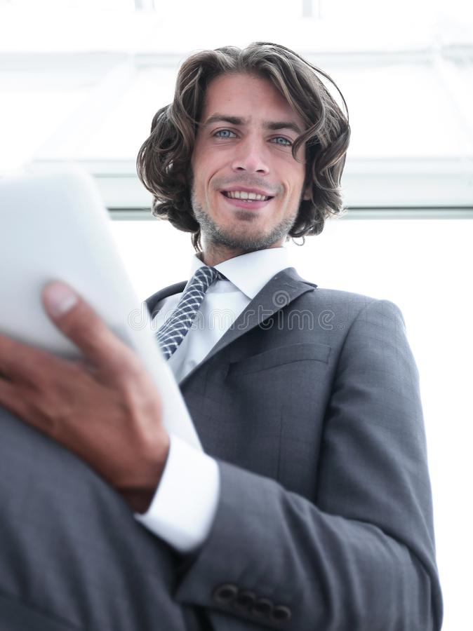 Closeup .businessman working on the tablet. stock photography