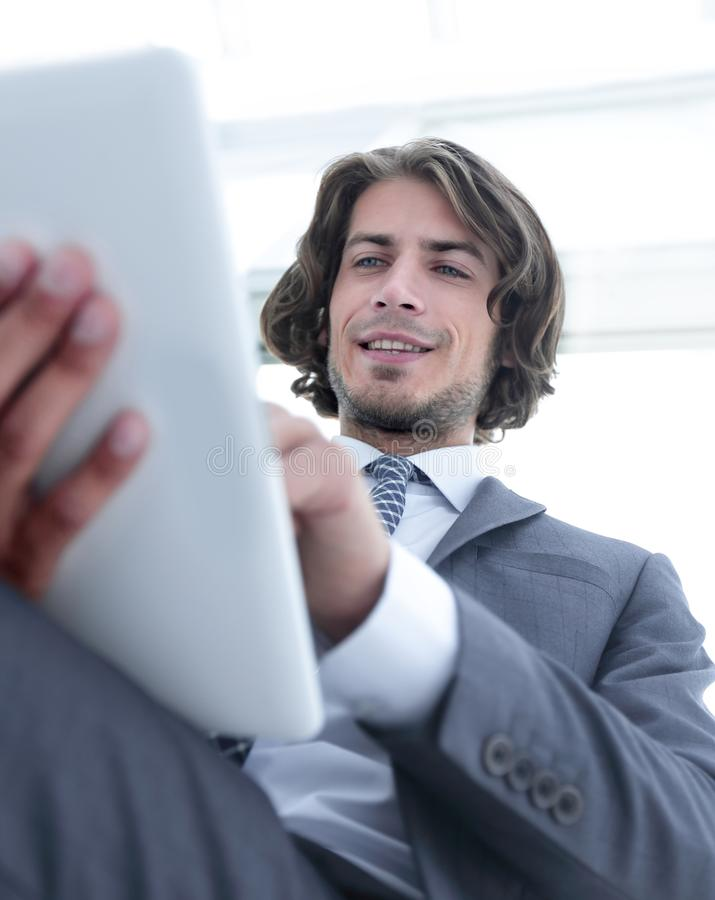 Closeup .businessman working on the tablet. royalty free stock image