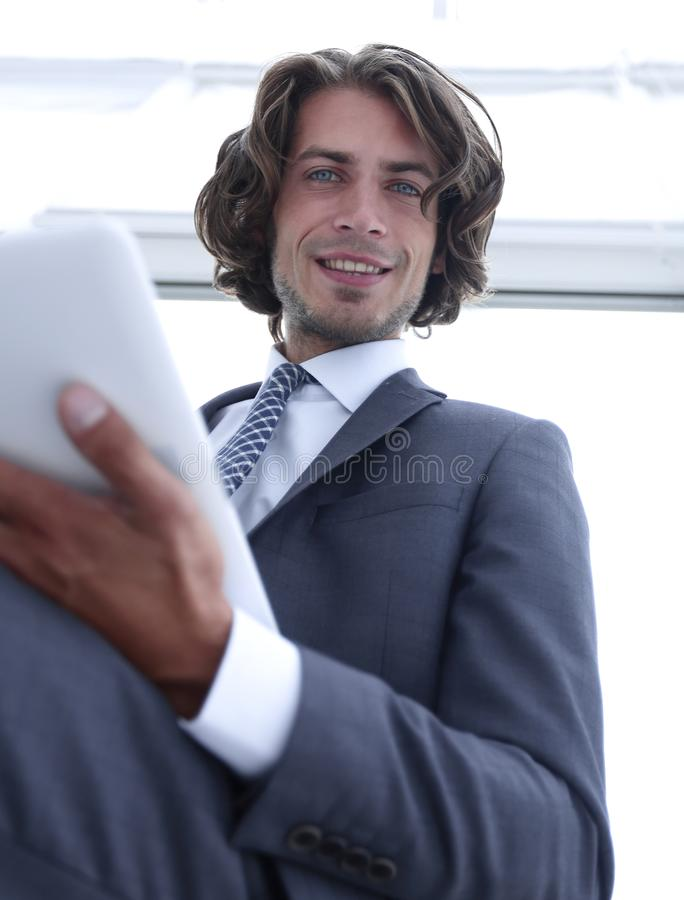 Closeup .businessman working on the tablet. stock photo
