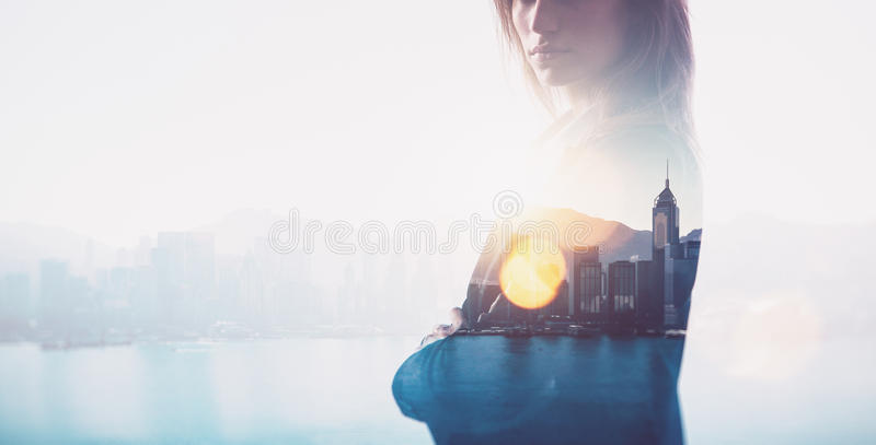 Closeup of businesswoman. Double exposure, city and bay on the background. Blurred background, horizontal. Photo of businesswoman. Double exposure, city on the stock image
