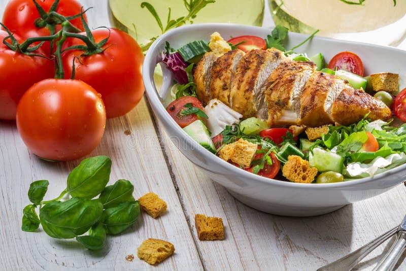 Closeup of caesar salad and fresh ingredients stock image