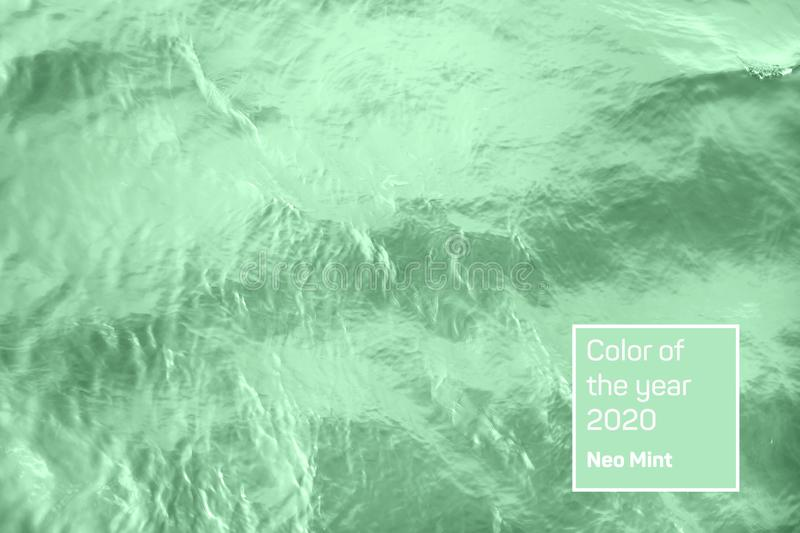 Calm mint colored river water surface. Closeup of calm river water surface with water splashes in trendy neo mint color. Ideal river, sea and ocean texture royalty free stock photo