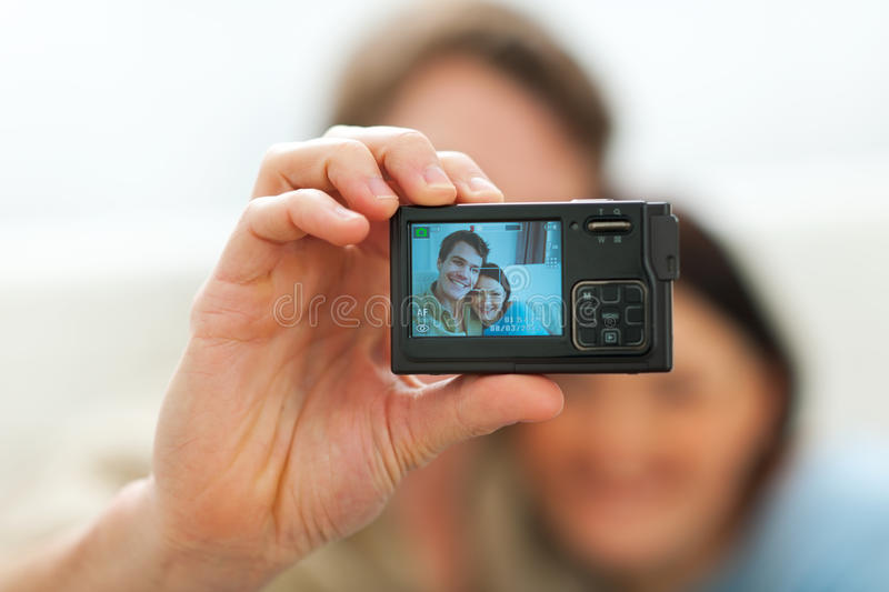 Download Closeup On Camera Making Portrait Of Couple Stock Photo - Image: 23462500