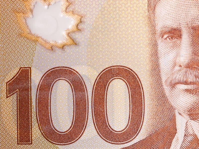 Closeup of a Canadian 100-dollar bill. Macro of Canadian 100-dollar bill stock image