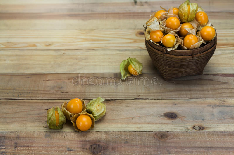 Closeup Cape gooseberry on wooden stock photos