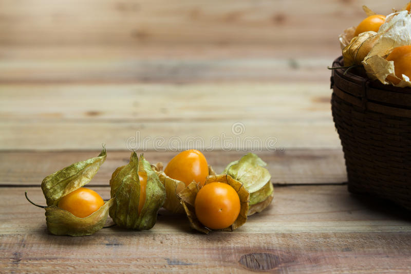 Closeup Cape gooseberry on wooden royalty free stock images