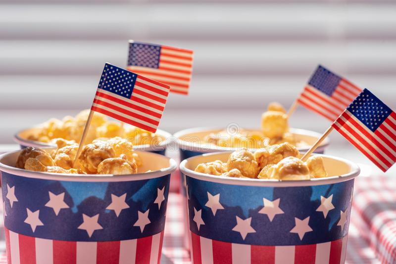 Closeup of caramel corn in patriotic snack cups. For Fourth of July celebration royalty free stock images