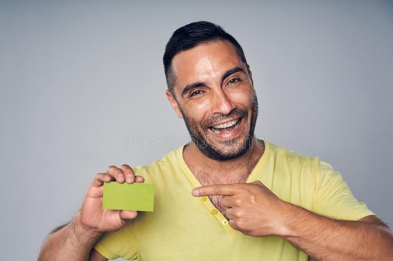 Closeup of casual hispanic man showing blank credit card stock images