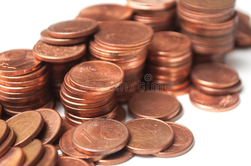 Cents of euro coins piles on white background. Closeup of cents of euro coins piles on white background royalty free stock photos