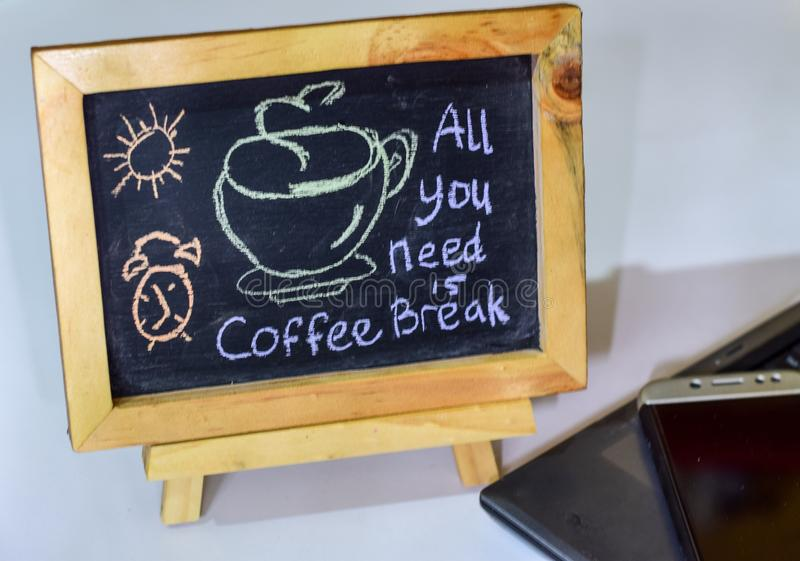 Closeup chalkboard with the phrase coffee break written on it. recharge stock image