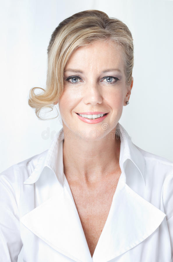 Closeup of cheerful, approachable blonde woman stock photos