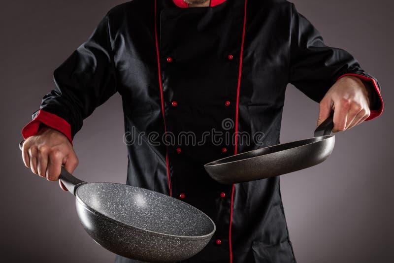 Closeup of chef holding empty frying pan stock photos